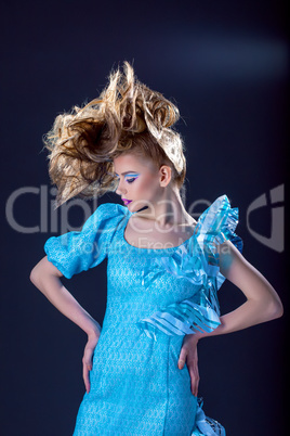 Confident model posing with creative hairstyle
