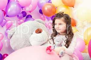 Lovely dark-haired girl posing with teddy bears