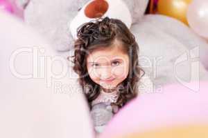 Portrait of lovely little brown-eyed girl