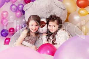 Lovely girlfriends posing with big teddy bear