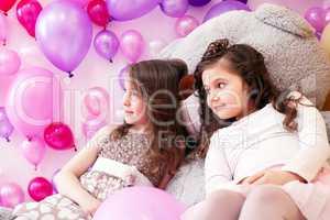Image of elegant girlfriends posing in playroom