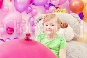 Amusing blonde girl posing in playroom
