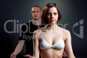 Yoga studio. Portrait of trainers posing at camera