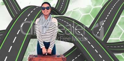 Composite image of asian woman with luggage looking at the camer