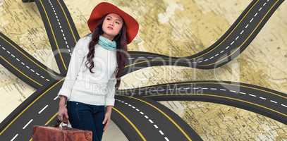Composite image of asian woman with hat holding luggage