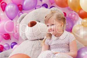 Studio shot of neat little girl posing in playroom