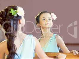 Reflection of graceful little ballerina, close-up