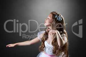 Beautiful emotional girl dancing in studio