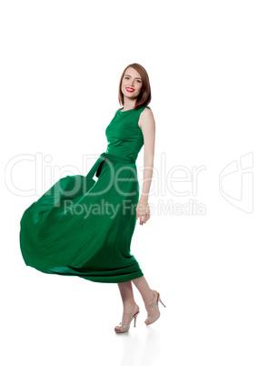Beautiful brunette posing in trendy green dress
