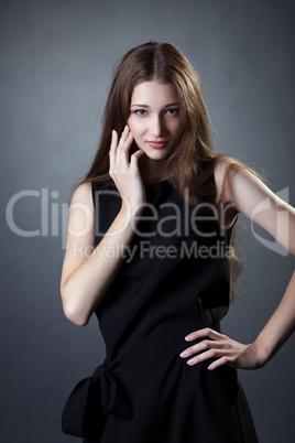 a81b69d7b6b Pretty young girl posing in trendy black dress  Royalty-free images ...