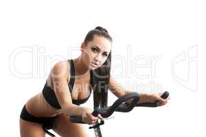 Portrait of sexy young woman posing on bike