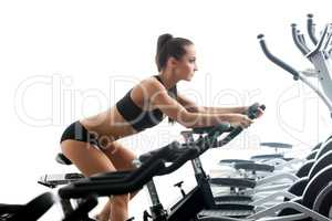 Image of sexy woman exercising on stationary bike