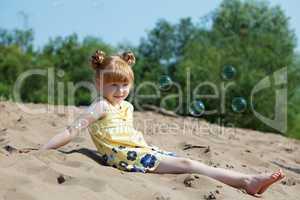 Amusing red-haired girl resting on beach
