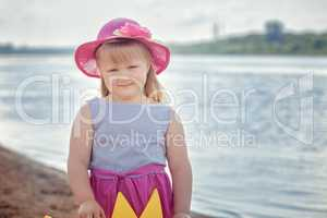 Image of little fair-haired girl posing at camera