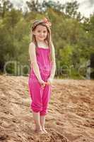 Shy pretty girl posing on beach in park