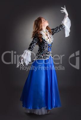 Artistic young woman posing in elegant suit
