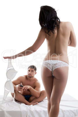 Sexy girl trying to distract man from cellular