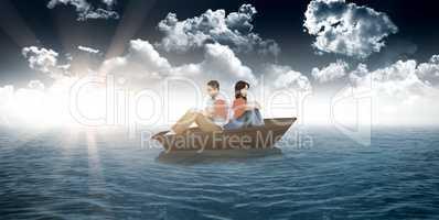 Composite image of sad couple holding broken heart pieces