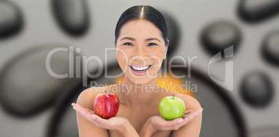 Composite image of smiling natural brunette holding apples in bo
