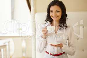 Attractive business woman during coffee break