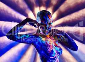 Amazing painted nude girl glowing under neon light