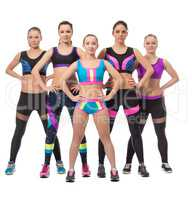 Team of pretty female athletes posing at camera