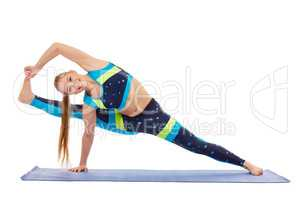 Cute athlete doing difficult stretching exercise
