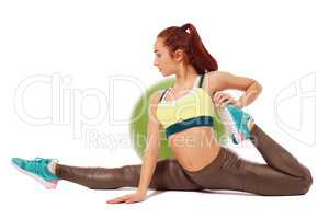 Side view of flexible girl exercising aerobics