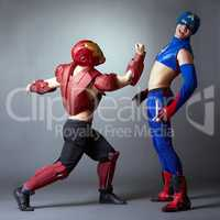 Confrontation of superheroes. Sexy male dancers