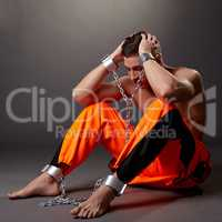 Hopeless man in handcuffs grabbed his head