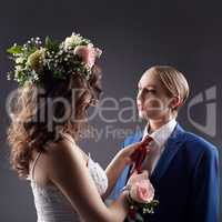 Gay wedding. Bride straightens groom's tie