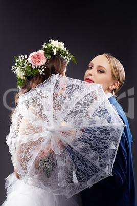 Idea of same-sex marriage. Pretty bride and groom
