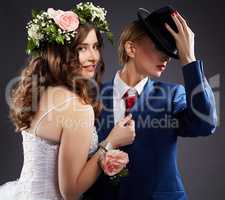 Same-sex marriage. Newlyweds in elegant clothes