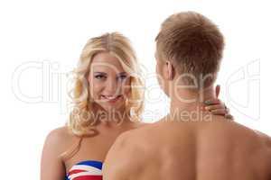 Smiling blonde touching her boyfriend's neck