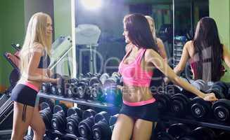 Seductive girls while training with dumbbells