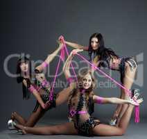 Studio shot of pop female dancers posing at camera