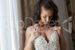 Fascinating bride looks at her decollete