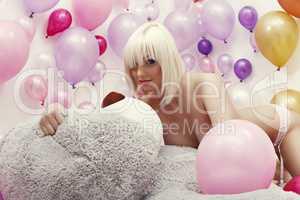 Studio photo of exciting platinum blonde posing