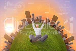 Composite image of cheering businesswoman sitting cross legged