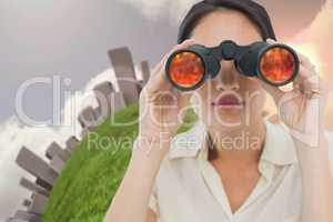 Closeup of a businesswoman looking through binoculars