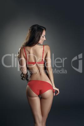 Advertising underwear. Model posing back to camera