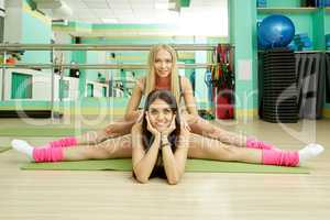 Gym. Sporty women doing gymnastic splits