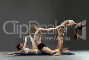 Yoga. Group of trainers posing in studio