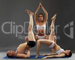 Yoga composition. Flexible people posing at camera