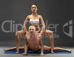 Yoga. Flexible athletes posing at camera