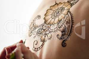 Beautiful henna patterns in process of applying