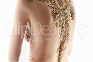 Art of mehndi. Topless model posing back to camera