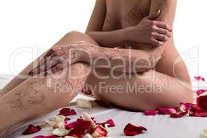 Nude woman with henna patterns on body, close-up
