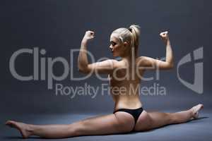 Studio shot of sexy flexible girl posing topless