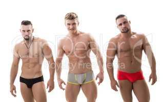 Photo of three sexy macho with bare torsos